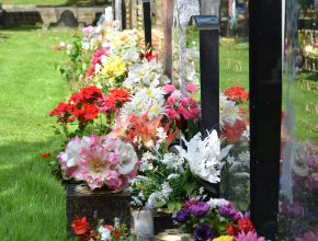memorial grave with flowers on